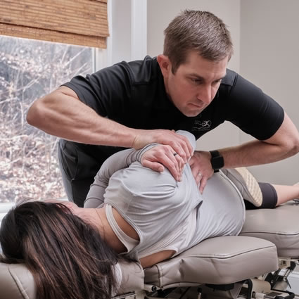 Dr. Tyler adjusting