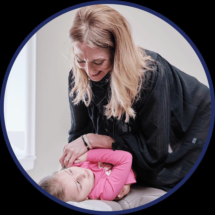 Dr. Jessica adjusting little girl