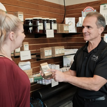 Dr. Charles showing supplements to patient