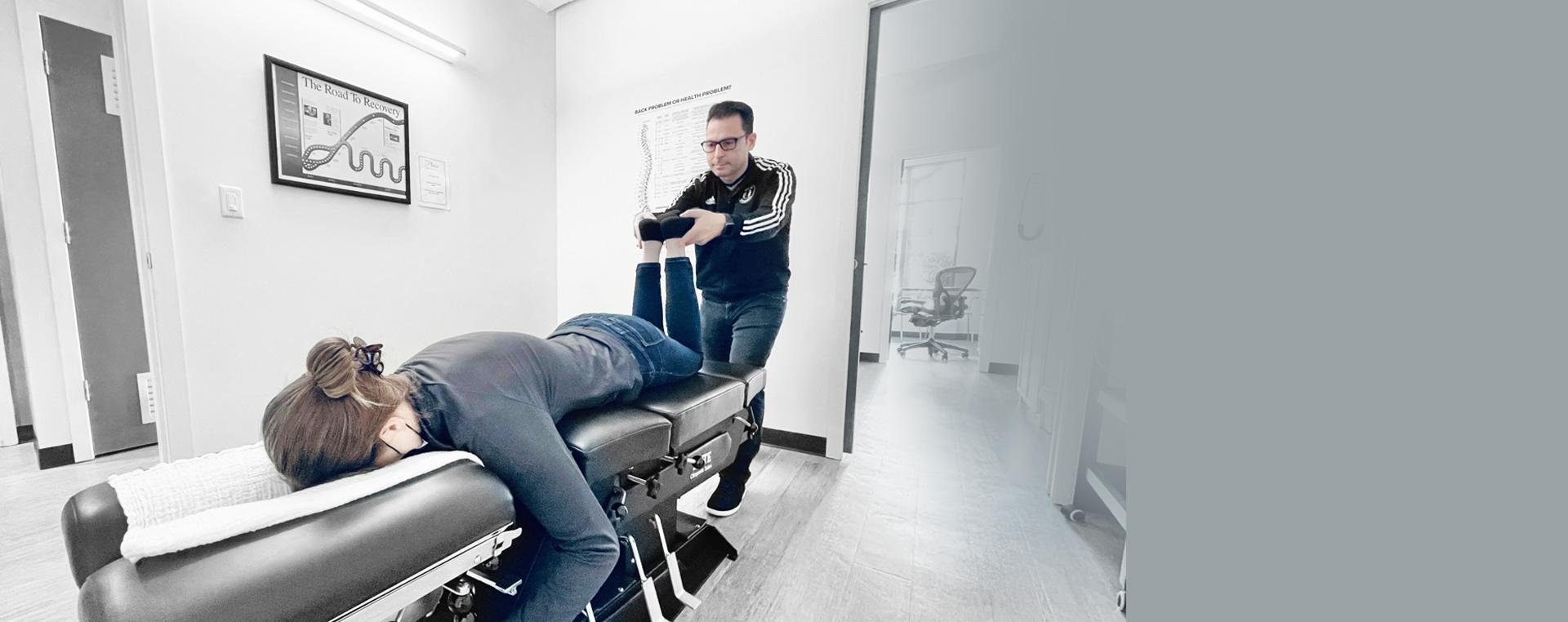 Dr. Barone checking members legs