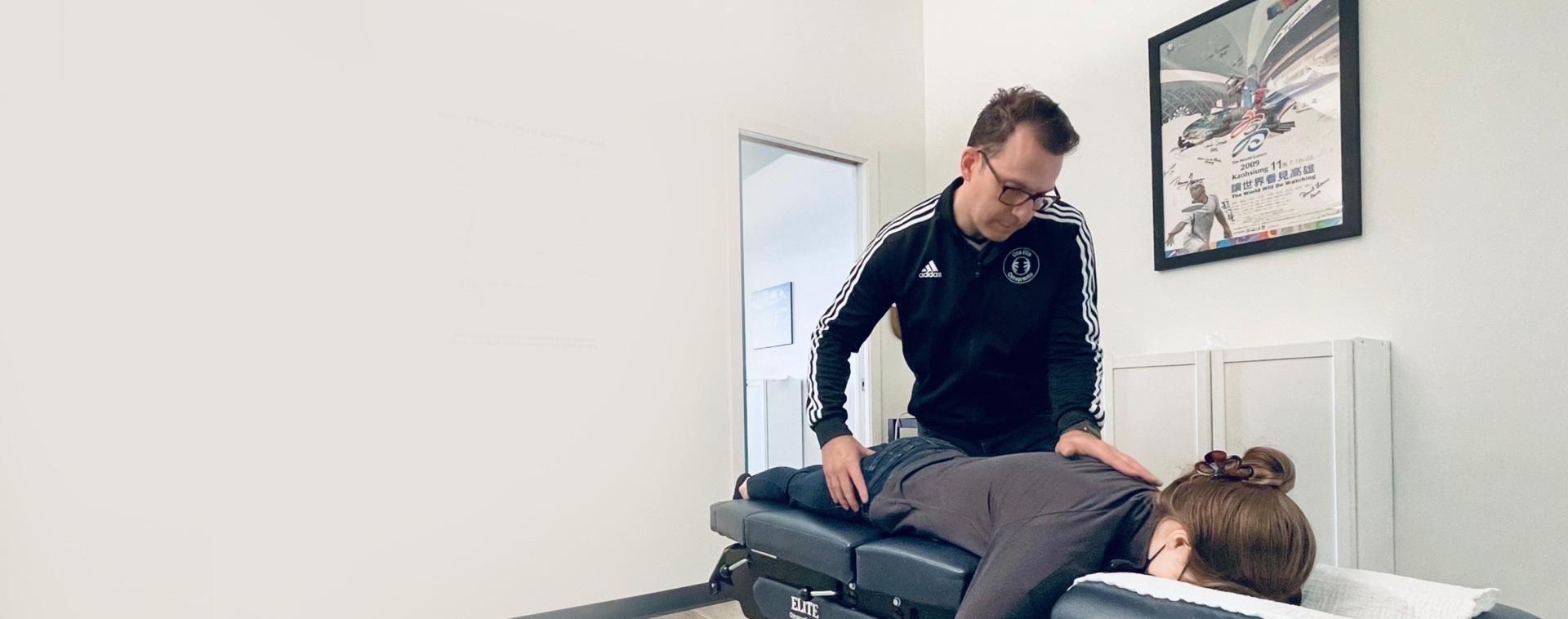 Dr. Avise adjusting patient on table