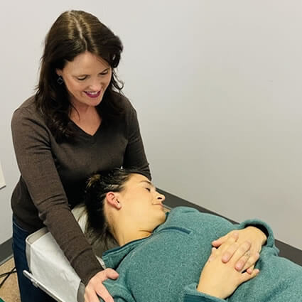 Dr. Beth stretching patient neck