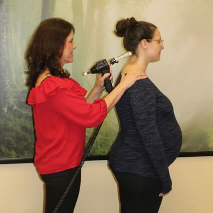 Pregnant woman being adjusted