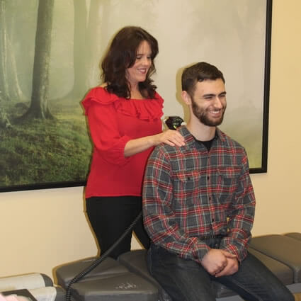 Man getting adjusted while sitting