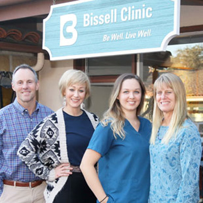 Bissell Clinic team on stairs