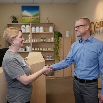 Dr. Ritchie shaking hands with patient