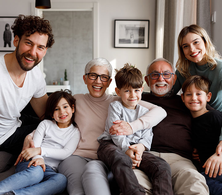 multi-generational family picture on sofa