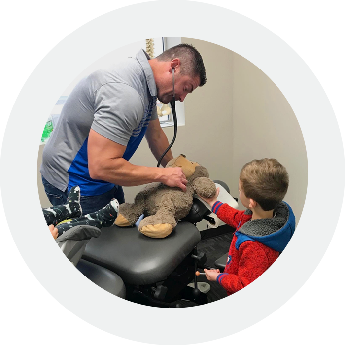 Dr. Adam Evans caring for teddy bear