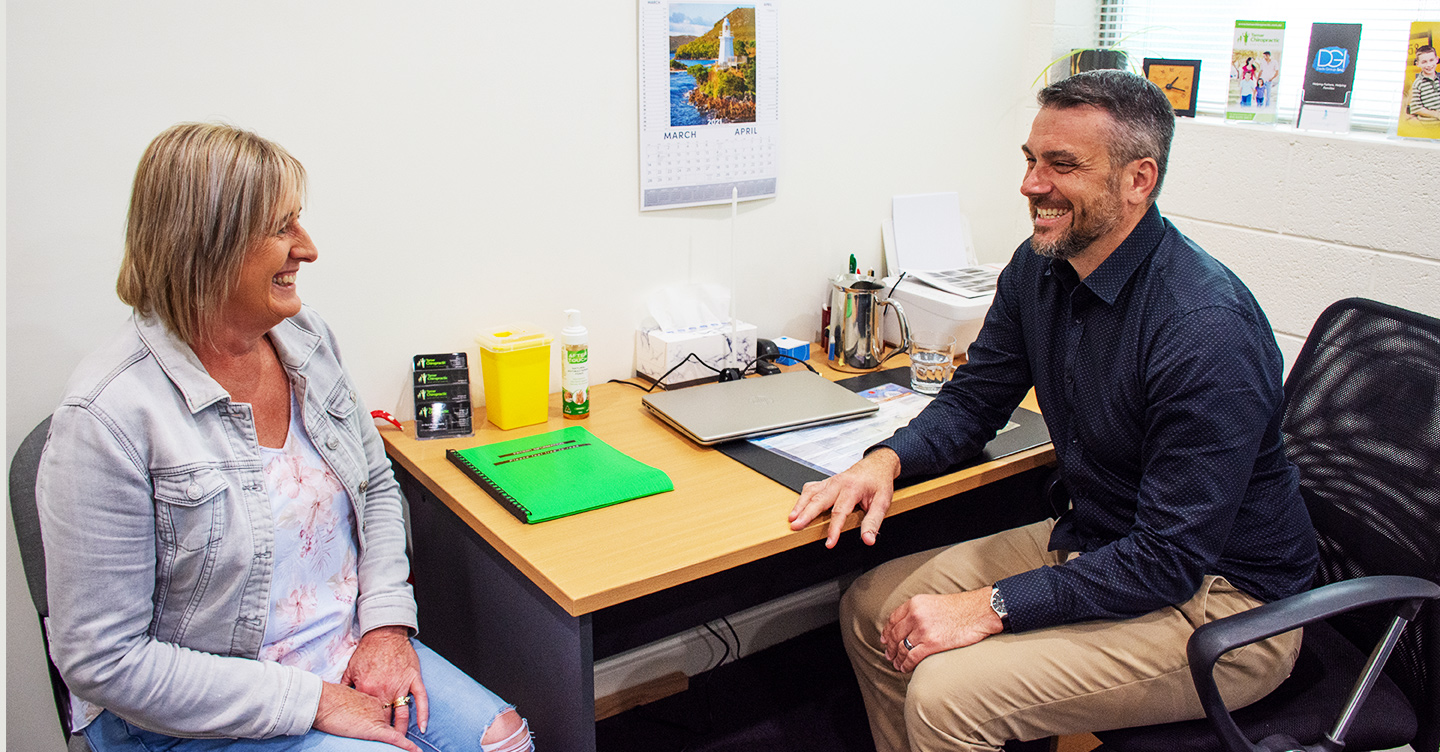 Doctor laughing with patient