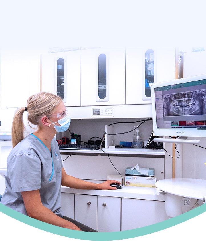 hygenist looking at dental xray