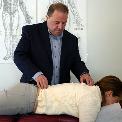 Dr Vinny touching patients back