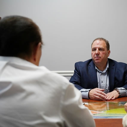 Dr. Vinny meeting with patient