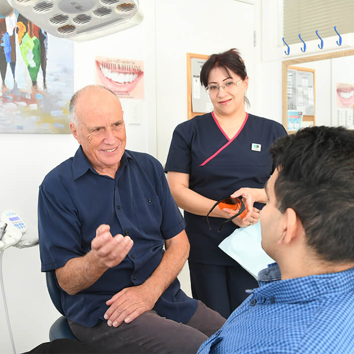 male dentist with patient