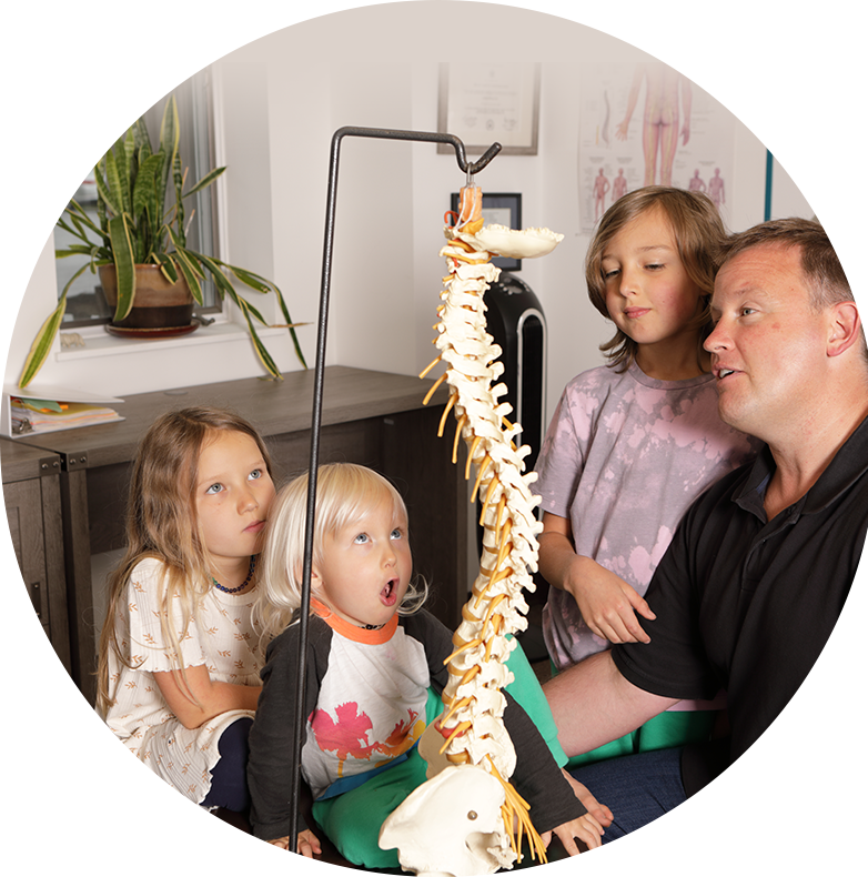 kids looking at spine model