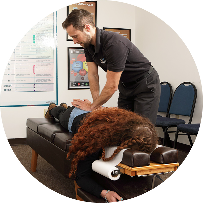 chiropractor adjusting womans lower back