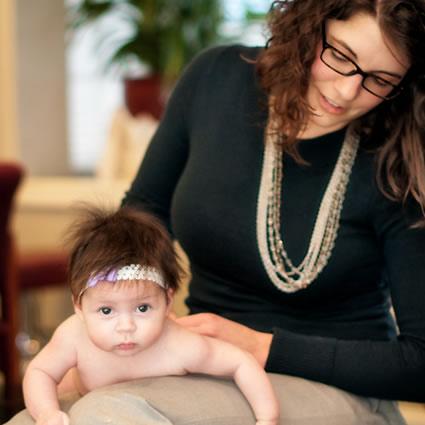 Dr. Morgan adjusting infant