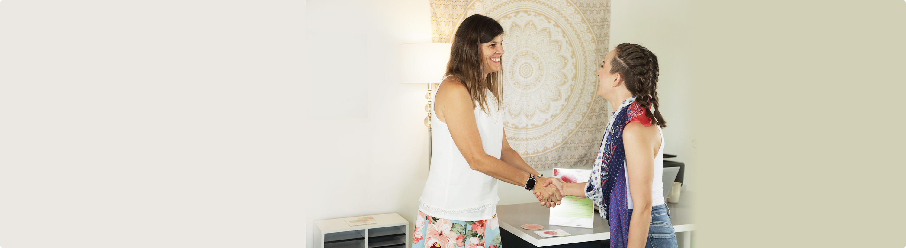 Dr. Stephanie shaking hands with patient