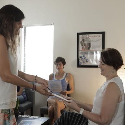 Handing paperwork to patient