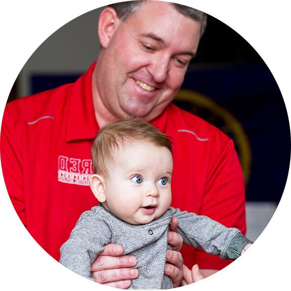 Dr. Carpenter holding baby