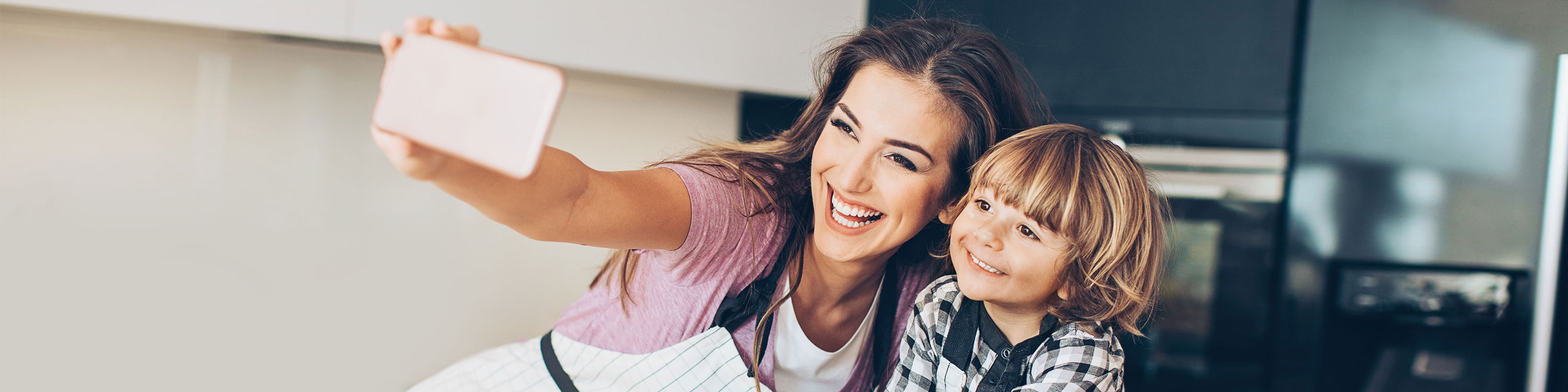 mother and child taking selfie
