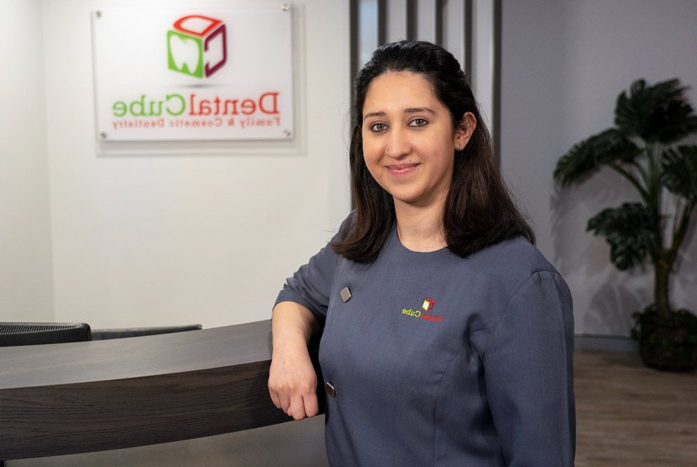 Dr. Amrita standing near front desk