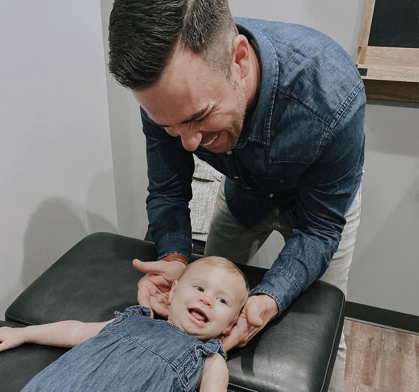 doctor adjusting baby