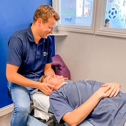 Doctor adjusting mans neck