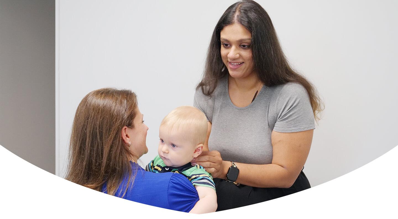 Doctor adjusting infants neck