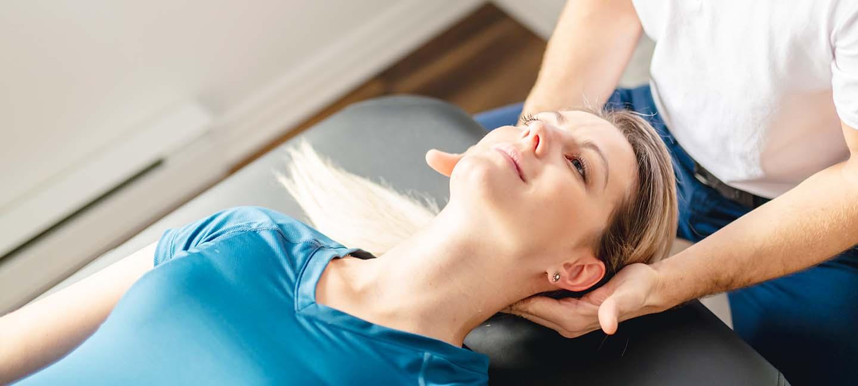 massaging woman's neck