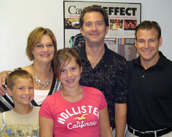 Dr. Baker with his patient Cathy and her family.