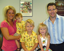 Dr. Baker with Carrie and her family.