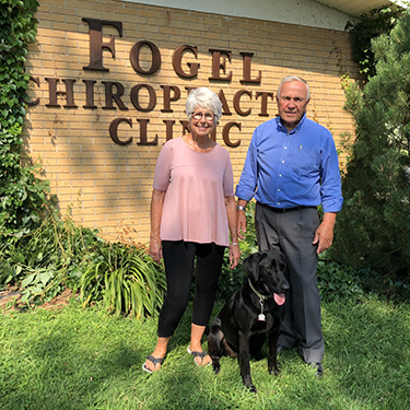 Dr. Jerry and his wife Betty with the family dog