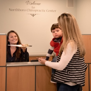 Patients Being Greeted Reception Desk