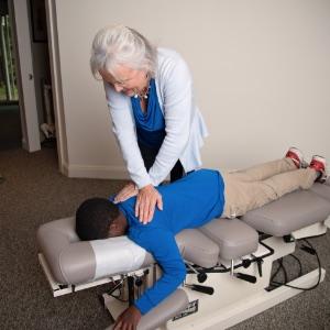 Dr. Karen Adjusting Young Patient