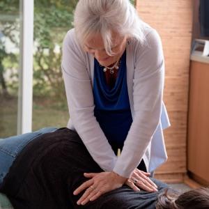 Dr. Karen Adjusting Pregnant Mom