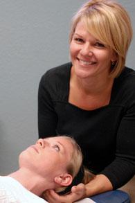 Chiropractor in Colorado Springs, Dr. Lynn Cash adjusting a patient.