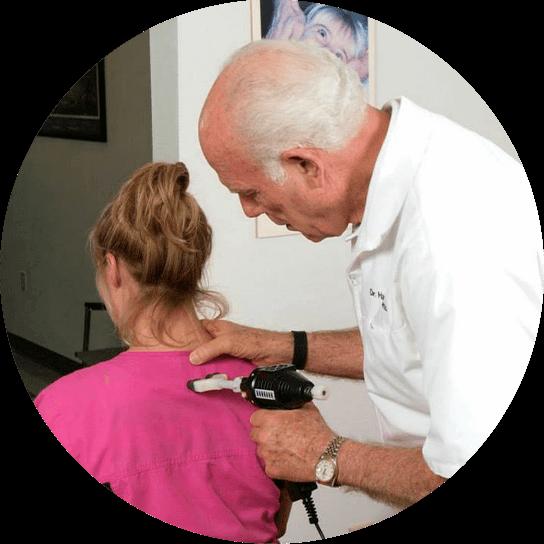 Dr. Wolverton adjusting patient