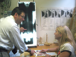 Dr. Phelps showing a patient her x-rays during the second visit Report of Findings