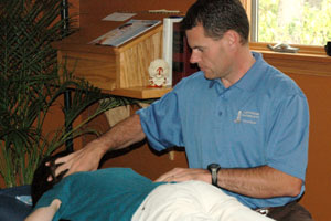 Dr. Kurt Froese prepares to adjust a patient.