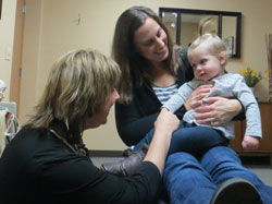 Waterford Chiropractor Jenny Geiger with a baby