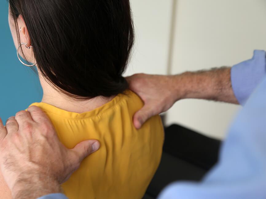 Dr Diamond adjusting womans neck