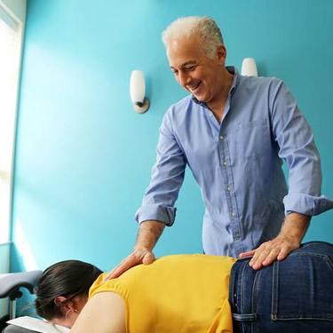 Dr. Diamond adjusting patients back