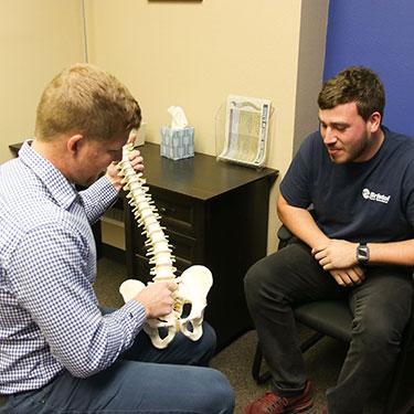 Dr. Suntken holding spine model