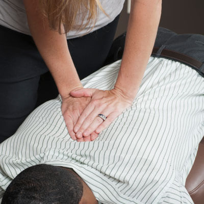 Person getting a chiropractic adjustment on their back