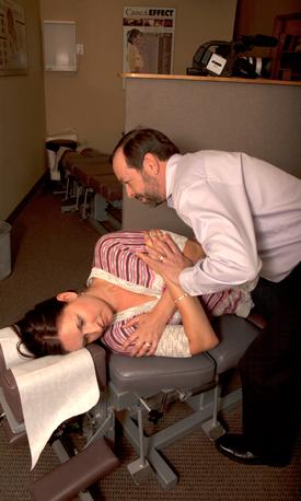 Dr. St-Denis adjusting a patient