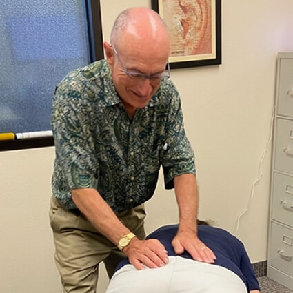 Dr. Wills with hands on low back
