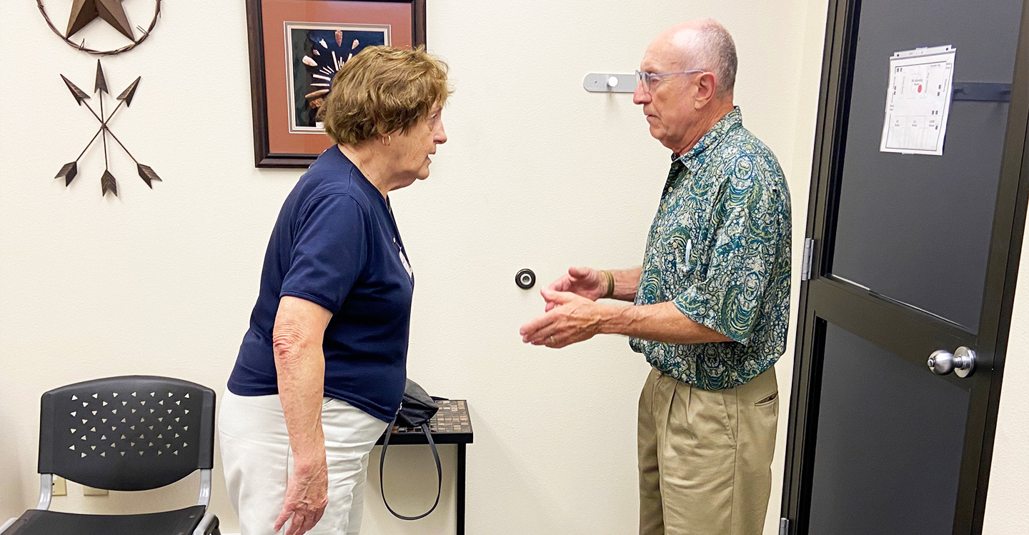 Dr. Wills greeting patient
