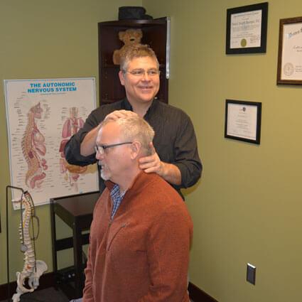 Dr. Dan adjusting mans neck