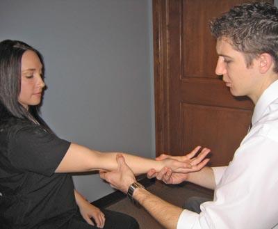 Dr. Aaron examining patient
