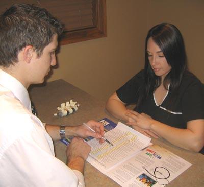 Dr. Aaron explaining treatment to patient